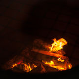 Fire flames on black background - barbecu fire place Stock Photos