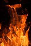 Fire flames on a black background. Blaze fire flame texture background. Close up of fire flames isolated on black background. Burn Royalty Free Stock Photo
