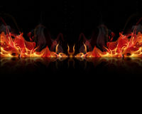 Fire flames on a black background Stock Photos