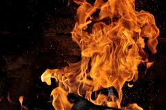 Fire. Flames with a black dark background royalty free stock photography
