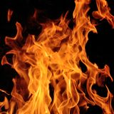 Fire. Flames with a black dark background royalty free stock images