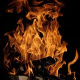 Fire. Flames with a black dark background stock images