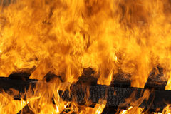 Fire Flames Burning. Intense flames burning a charred wooden structure Royalty Free Stock Photo