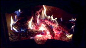Fire with flames burning. From olive tree logs in a chimney closeup stock footage