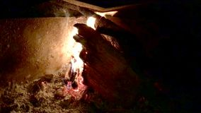 Fire with flames burning. From olive tree logs in a chimney closeup stock video footage