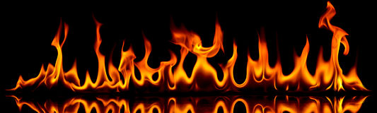 Fire and flames. Creative photo of fire flames on black background royalty free stock photos
