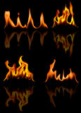 Fire flames. On a dark background Royalty Free Stock Photography