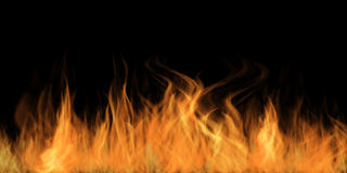 Fire Flames. On a dark background Stock Photo