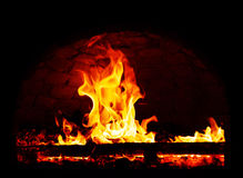 Fire flames on a dark background.  Royalty Free Stock Images