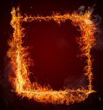 Fire flames frame on black background Stock Images