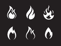 Fire flames icons set. White on a black background Royalty Free Stock Images