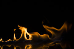 Fire and flames. Fire flames with reflection on black background Royalty Free Stock Photos