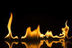 Fire and flames. Fire flames with reflection on black background Stock Image