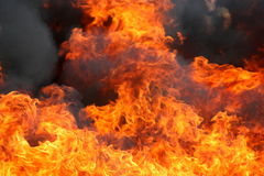 Fire. And flames and smoke Royalty Free Stock Images