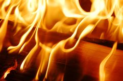 Fire flames VII. A flaming and warm wood fire royalty free stock photo