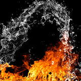 Fire flames with water splash. Over black background Royalty Free Stock Photos