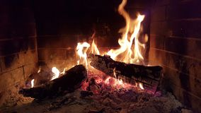 Fire flames woods in fireplace Stock Photos