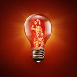 Fire flower inside light bulb Stock Photos