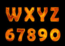 Fire font collection isolated on black background. Fire flame font caps Royalty Free Stock Photography