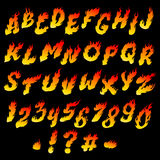 Fire font. Fiery alphabet and numbers on a black background Royalty Free Stock Images