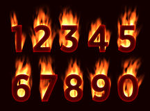 Fire font. Numbers in the fire. Alphabet with fire. Stock Images