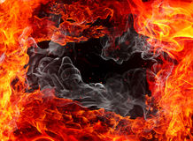 Fire frame. Flames, sparks and smoke on a black background Stock Image