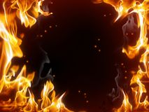 Fire frame. A frame of burning fire with sparks against the dark background Royalty Free Stock Image