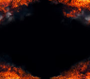Fire_frame_3. Fire corner frame over black background Stock Photo