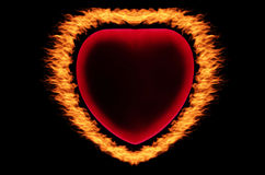 Fire frame. Heart on the black background Stock Photography
