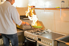 Fire in a frying pan Stock Images