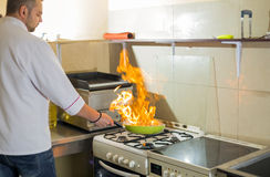 Fire in a frying pan Stock Photography