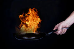 Fire on frying pan Royalty Free Stock Photo