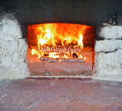 Fire in the Furnace. Burning Firewood in the brick Furnace royalty free stock image