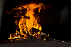 Fire in the furnace. Photo fiery flame burns in the blast furnace Stock Photo