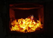 The fire in the furnace. Ember and fire close up. Coals, flames, heat,  relax concept background royalty free stock photos