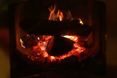 The fire in the furnace. Wood burning in the furnace Fire  background Stock Photos