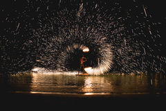 Fire games. A man play with fire on the sea - thailand Royalty Free Stock Photo