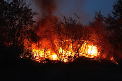Fire. The garden society burns wooden house. Fire in Kaliningrad. The garden society burns wooden house Stock Image