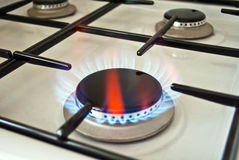 Fire on a gas-furnace. Blue flame on a gas-furnace Royalty Free Stock Photo