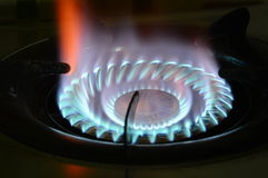 Fire on gas stove in kitchen Royalty Free Stock Photography