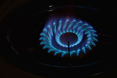 Fire on gas stove in kitchen Stock Images