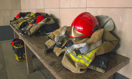 Fire Gear at table. Fire Gear on the table at interior royalty free stock images