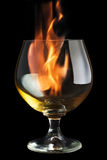 Fire and glass. Fire tongue inside glass, on black background Royalty Free Stock Photography