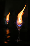 Fire glass reflection. Fire inside medium martini glass reflection Royalty Free Stock Photo
