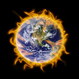 Fire Globe earth. A metaphor for global warming surrounds the earth in flames Royalty Free Stock Photography