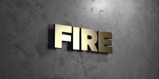 Fire - Gold sign mounted on glossy marble wall  - 3D rendered royalty free stock illustration. This image can be used for an online website banner ad or a Stock Photo