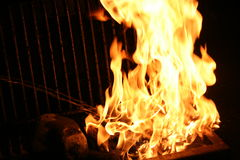Fire on the grill Stock Images