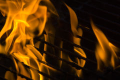 Fire on grill Royalty Free Stock Image