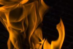 Fire on grill Stock Photos
