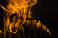 Fire on grill. A burning hot fire on grill Royalty Free Stock Photo